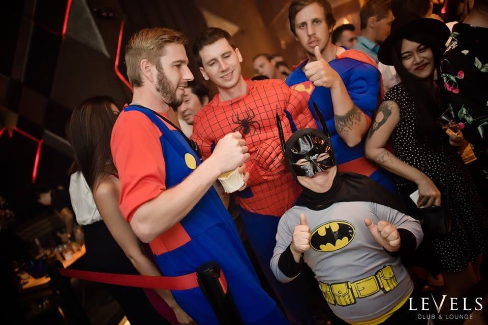 little person strippers at a night club in a batman costume
